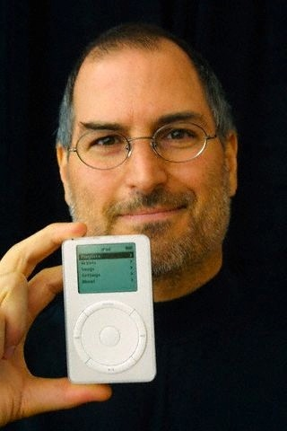The iPod didn't seem real. 1,000 CD-quality songs into an ultra-portable, 6.5 ounce design that fits in your pocket. With the first iPod introduction in 2001, Apple would ring the death knell for CDs and set the standard for music players, which continues to this day. Designed by Jonathan Ive, the iPod was created in less than a year and the software development was overseen by Jobs himself.