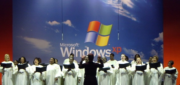 "Choir sings ""America the Beautiful"" during Windows XP's launch. The song had renewed meaning for many, following terrorist attacks against the World Trade Center and US Pentagon the previous month. [Nate Mook]"