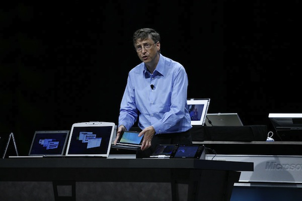 "Bill Gates introduces Ultra-Mobile PC, codename ""Origami"", in March 2006. Microsoft provided partners with reference designs, hoping for devices selling for under $500, but the first UMPCs sold for twice as much or more. [Microsoft]"