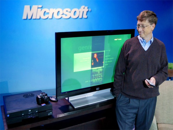 "About six weeks after Windows XP launched, Bill Gates debuted a second, media-oriented user interface codename ""Freestyle"".  The first Windows XP Media Center Edition PCs shipped for holiday 2002. Here Gates poses with MCE 2005, three years later. [Microsoft]"