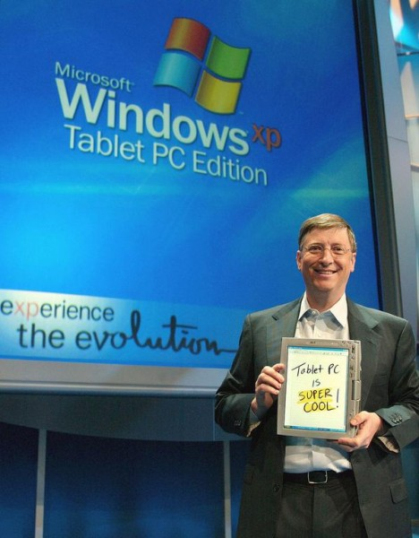 About three weeks after XP's launch, Gates unveiled Windows XP Tablet PC Edition during Comdex 2001. The first Tablet PCs debuted about a year later. Here Gates holds one during the November 2002 launch event. [Microsoft]