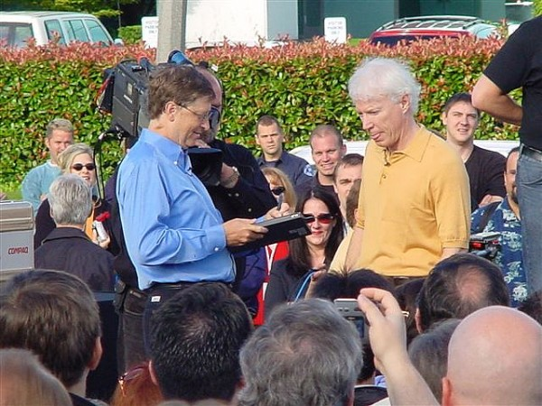 Bill Gates signs off Windows XP gold master, Aug. 24, 2001. A helicopter waits to fly off the code. [Ari Pernick]
