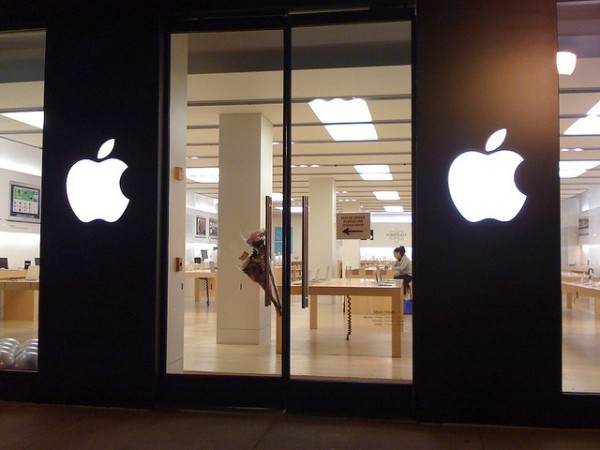 Flowers adorn an Apple Store door, hours after the world learned that Steve Jobs had died. [Blake Patterson]
