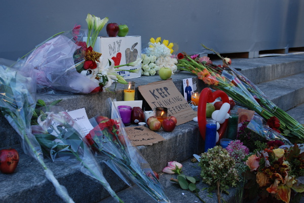 Flowers outside Apple's New York store commemorate Steve Jobs, who passed away Oct. 5, 2011. [Tim Conneally]