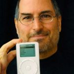 Apple CEO Steve Jobs Holding New MP3 Player