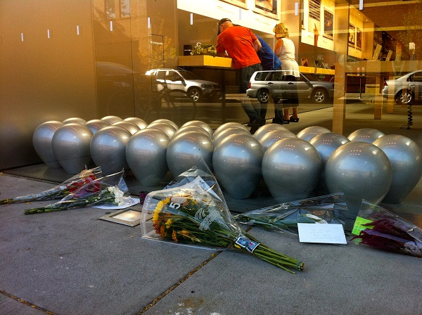 Mourners placed flowers outside Apple's uptown store in Minneapolis.  [Julio Ojeda-Zapata]