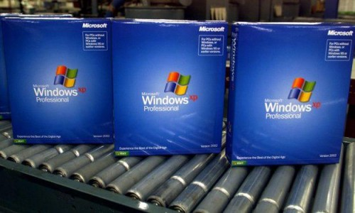 Windows XP boxes come off the assembly lines during simpler times. Microsoft offered only two versions of the operating system. [Microsoft]