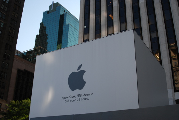 Apple's flagship store in New York is coincidentally enshrined for renovations. The somber gray covering the once mighty cube is seemingly appropriate for the people coming not to shop but to remember Steve Jobs.  [Tim Conneally]