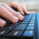 laptop keyboard fingers