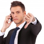 businessman thumbs down angry suit cell phone iPhone