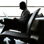 businessman laptop airport