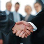 Boardroom handshake