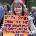 Occupy protester rich poor 99 percent