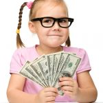 Child - girl - with money dollars