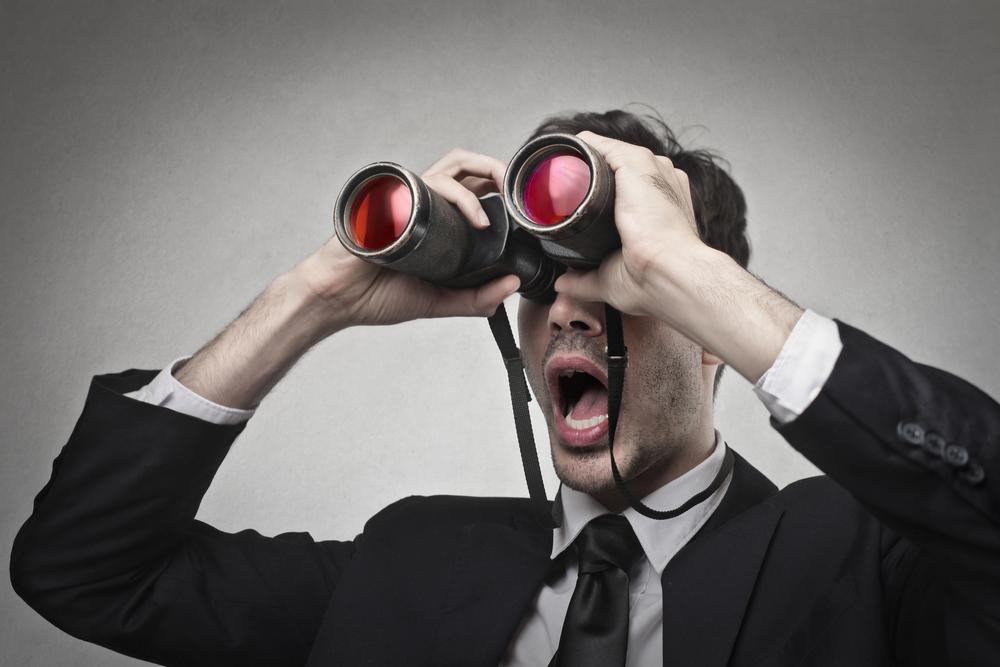 man binoculars distance