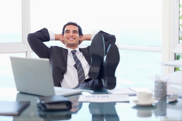 Satisfied Happy Businessman Relaxing Office