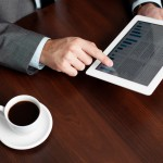 Businessman tablet reading coffee desk table touch