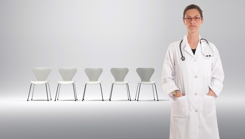 Doctor with empty waiting room