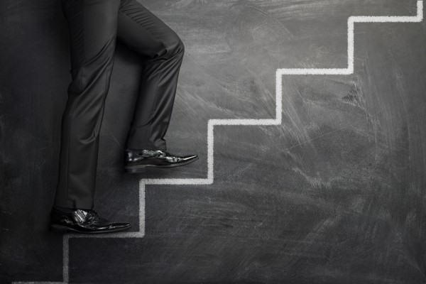 Businessman rise stairs chalk