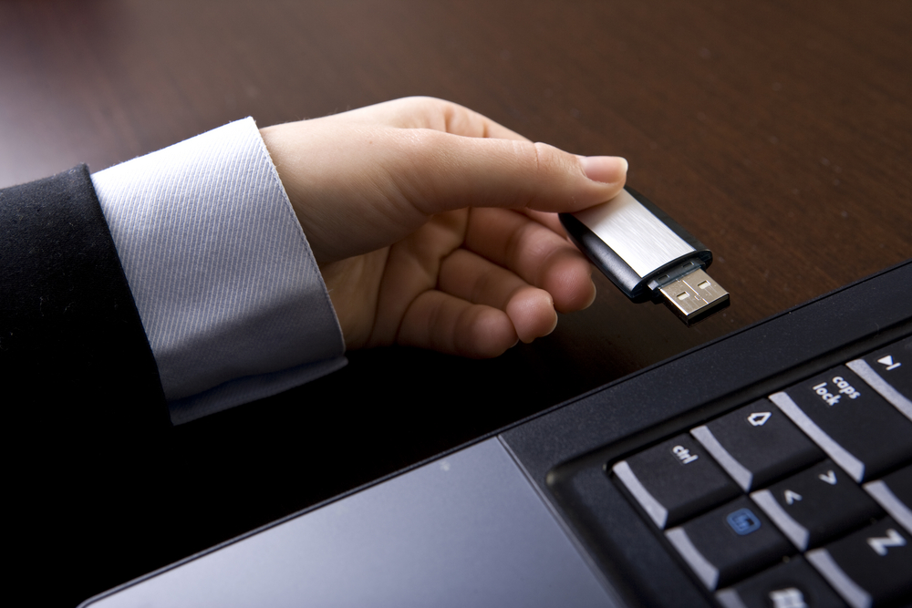 man hand usb flash laptop drive business suit