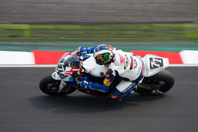 Honda TT Legends rider John McGuinness leaned on superbike on track