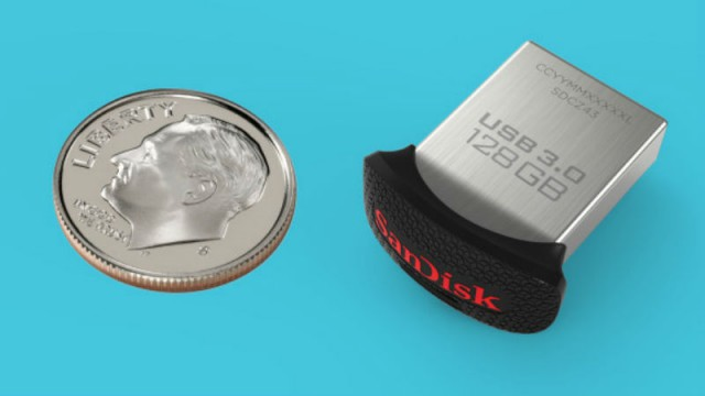 SanDisk 128 GB drive next to dime