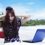 Unhappy laptop user on beach