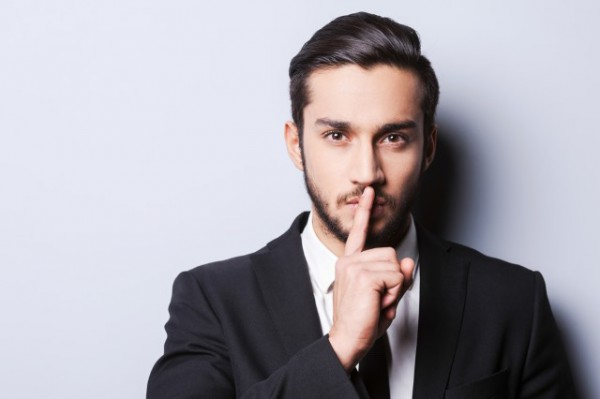secret_finger_on_lips