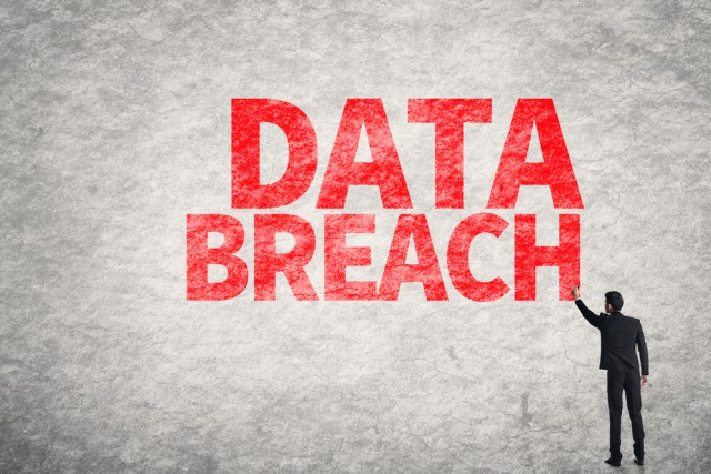Data breach wall writing man