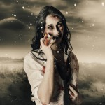 Deadly blizzard of falling snow pouring down on a dead female zombie crying tears of pain
