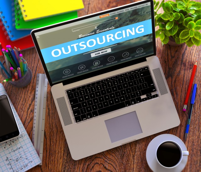 Outsourcing laptop coffee desk table office notebook