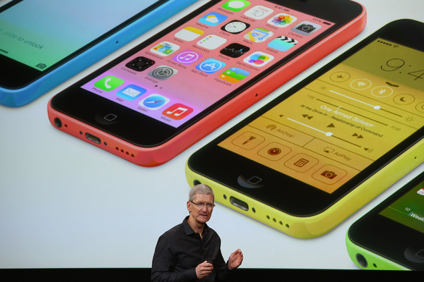 CUPERTINO, CA - SEPTEMBER 10: Apple CEO Tim Cook speaks about the new iPhone during an Apple product announcement at the Apple campus on September 10, 2013 in Cupertino, California. The company launched two new iPhone models that will run iOS 7. The 5C is made from a hard-coated polycarbonate and comes in five colors. The 5S comes in three colors, features a fingerprint sensor, has an upgraded camera, and contains an A7 chip. (Photo by Justin Sullivan/Getty Images)