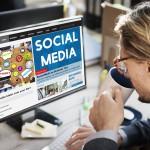 Social media news coffee man office PC