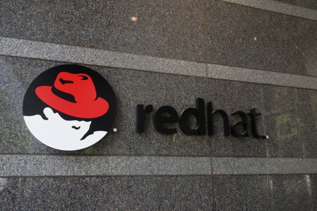 red hat logo sign
