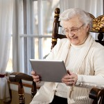 Old elderly woman tablet
