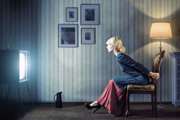 Woman watching TV television