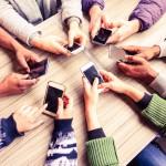 smartphones office desk team meeting break