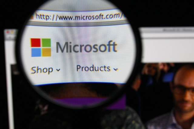 Microsoft logo under magnifying glass