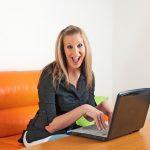 Woman_Laptop_Orange_Happy