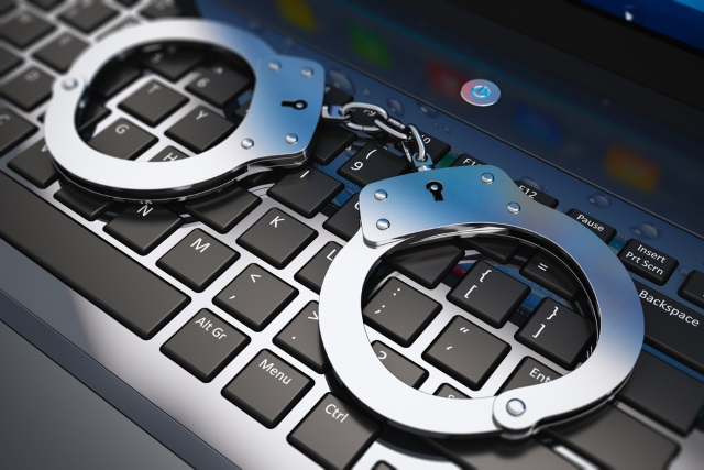 laptop-handcuffs
