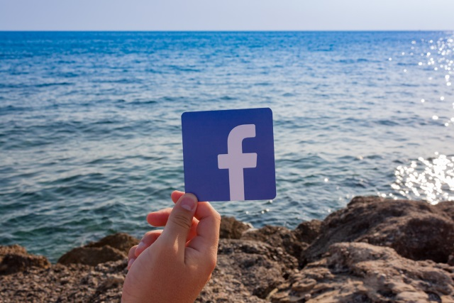 Facebook logo by the sea