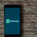 WhatsApp on a phone on a stone background