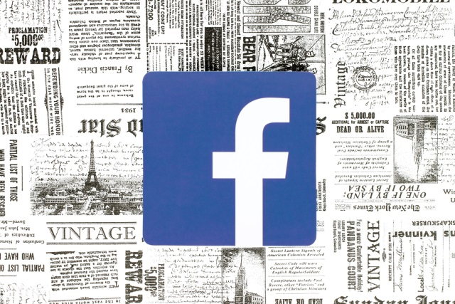 Facebook logo on newspaper background