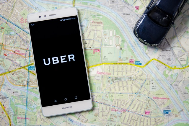 Uber on a phone sitting on a map
