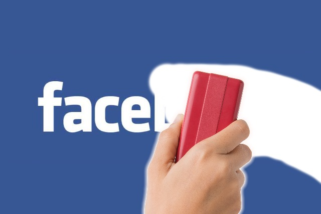 Hand erasing Facebook
