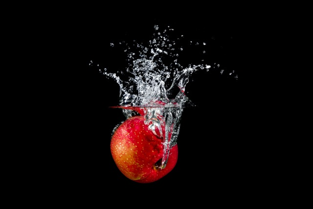 Apple dropped in water