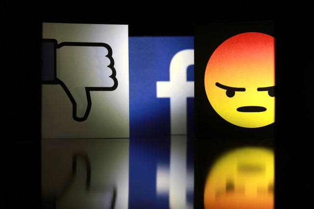 Facebook logo with angry icon and thumbs down