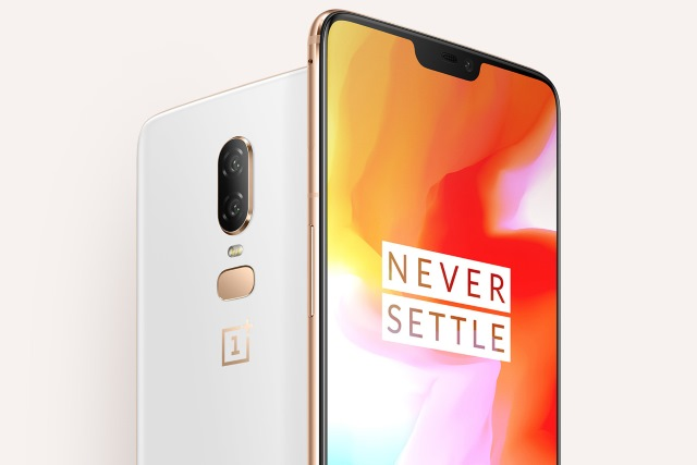 OnePlus 6 with Never Settle slogan