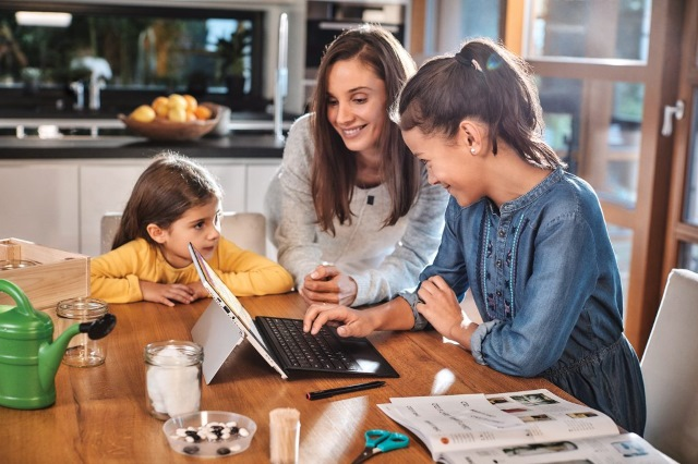 Parent and children at computer