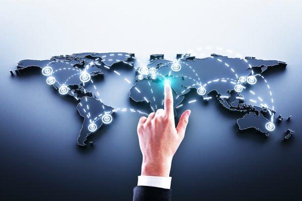 hand on world map